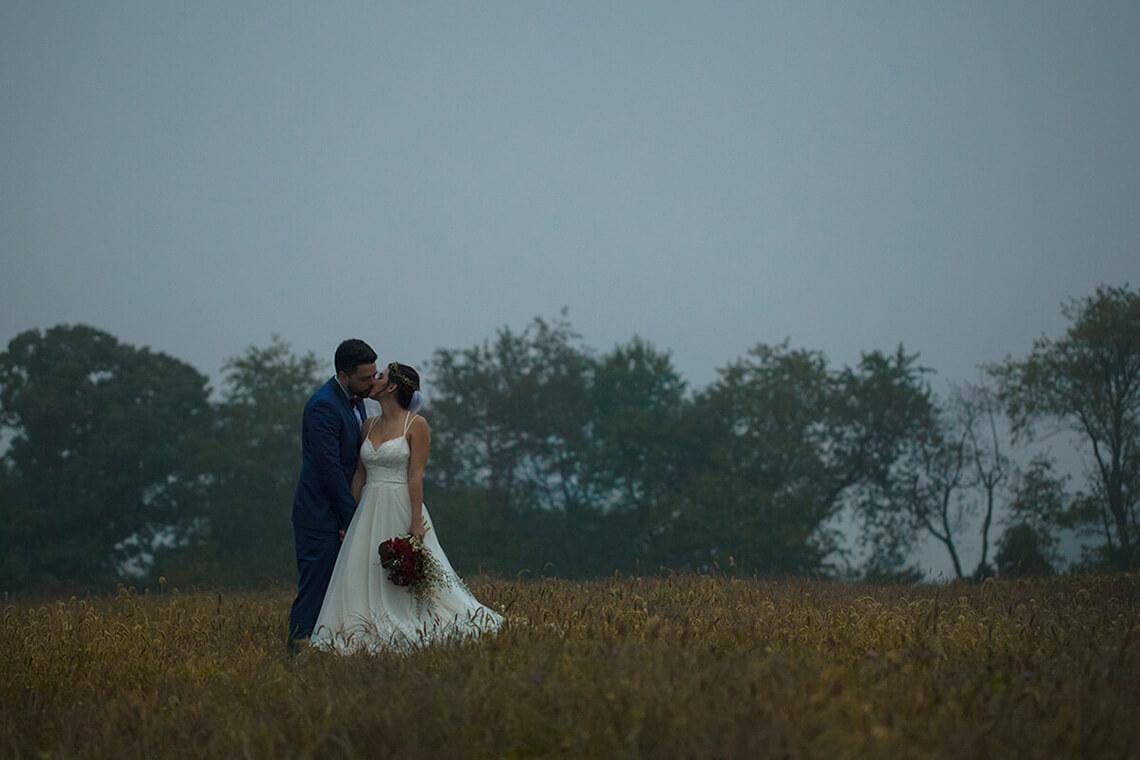 12-Wedding-Photographer-York-PA-Ken Bruggeman-Photography-Bride-Groom-Kissing-Field.jpg