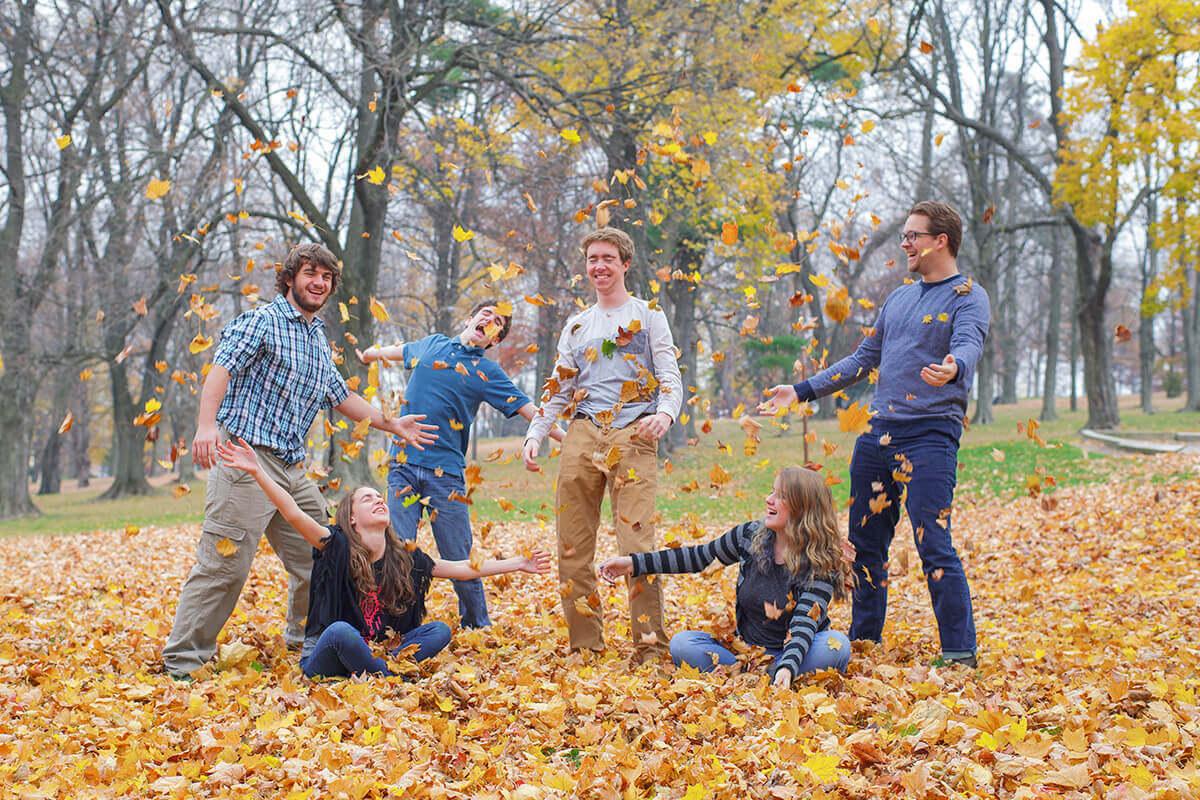 11-Photographer-York-PA-Ken-Bruggeman-Family-Portraits-Kids-Laughing-Throwing-Leaves.jpg