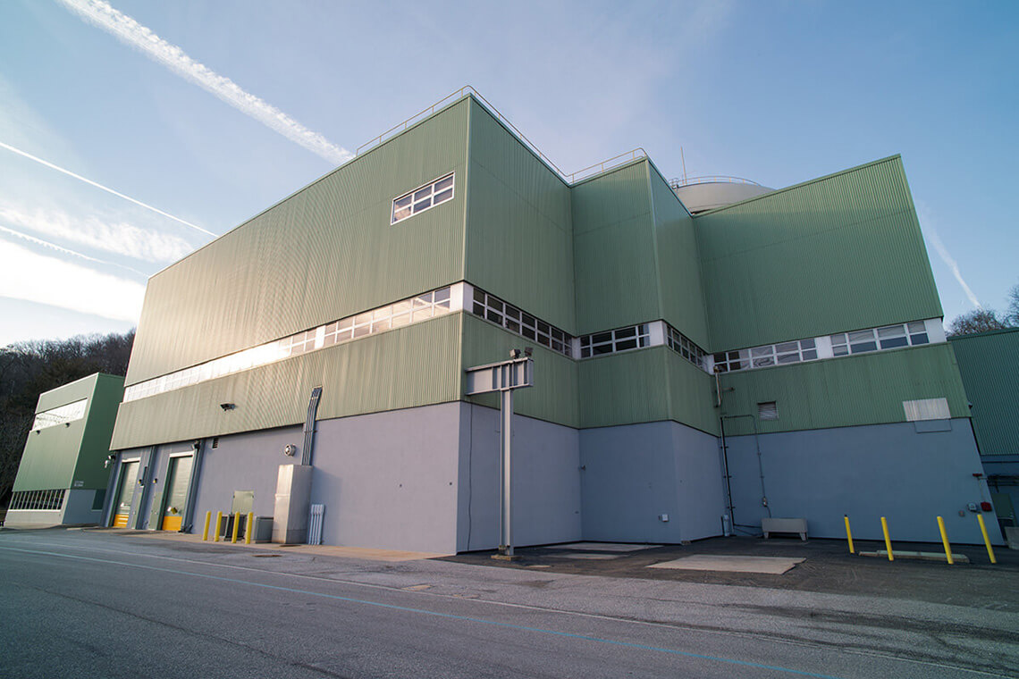5-Commercial-Architectural-Photographer-York-PA-Ken-Bruggeman-Photography-High-Security-Industrial-Building-Sun-Shining-Side-Windows-Green-Wall.jpg