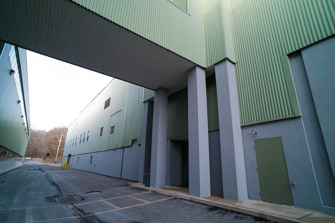 6-Commercial-Architectural-Photographer-York-PA-Ken-Bruggeman-Photography-High-Security-Industrial-Building-Green-Corrugated-Wall-Long-Drive-Through-Road.jpg