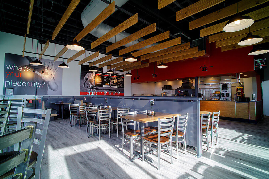 4-Commercial-Architectural-Photographer-York-PA-Ken-Bruggeman-Photography-Restaurant-Pie-Five-Pizza-Company-Metal-Chairs-Gray-Flooring-Dining.jpg