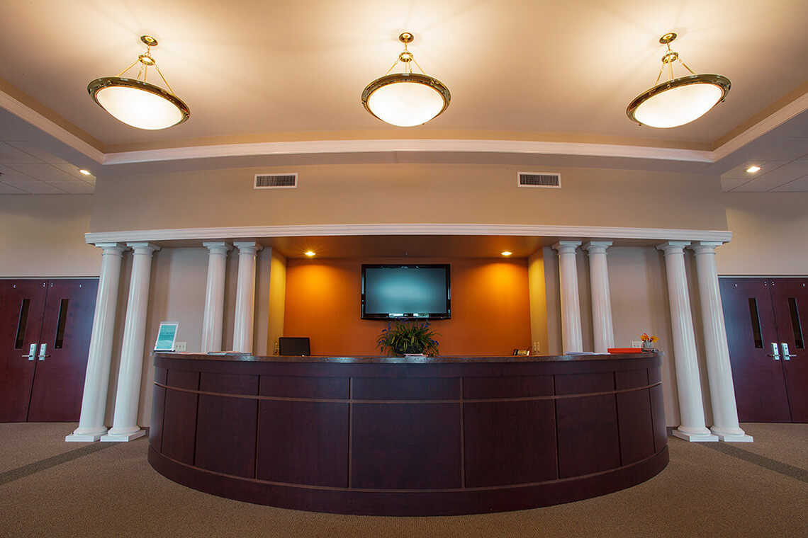 9-Commercial-Architectural-Photographer-York-PA-Ken-Bruggeman-Photography-Reamstown-Church-God-Front-Desk-Orange-Wall-Lighting.jpg