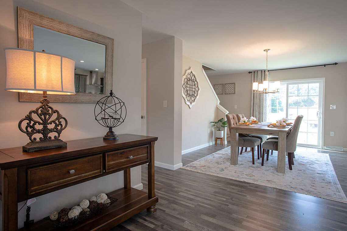 7-Commercial-Photography-Residential-Real-Estate-Interior-Ken-Bruggeman-Photography-York-PA-Pleasant-Valley-Homes-Elegant-Dining-Room-View-Foyer.jpg