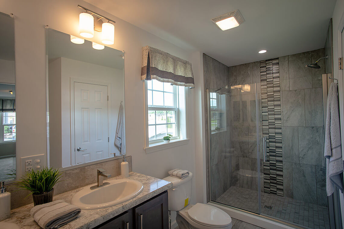 10-Commercial-Photography-Residential-Real-Estate-Interior-Ken-Bruggeman-Photography-York-PA-Pleasant-Valley-Homes-Modern-Bathroom-Tile-Glass-Shower.jpg