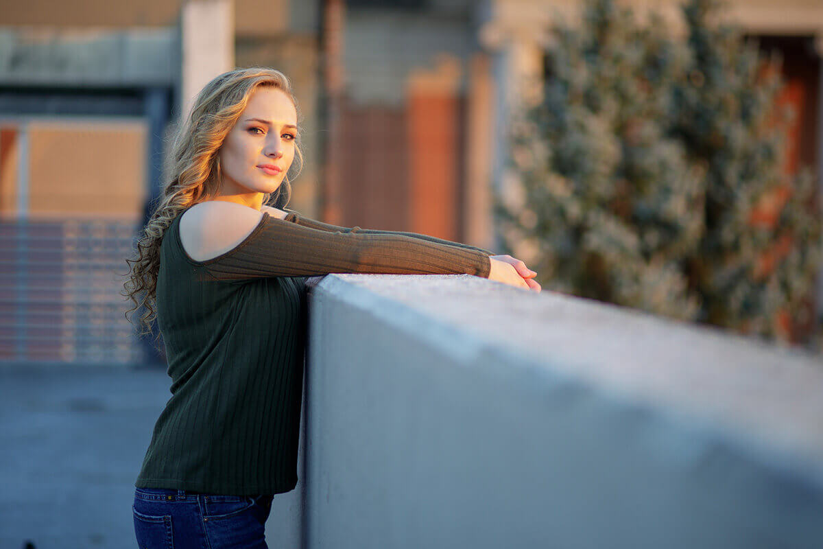 6-Senior-Portrait-Photographer-York-PA-Ken-Bruggeman-Photography-Central-High-School-Young-Woman-Green-Shirt-Resting-Wall-City.jpg