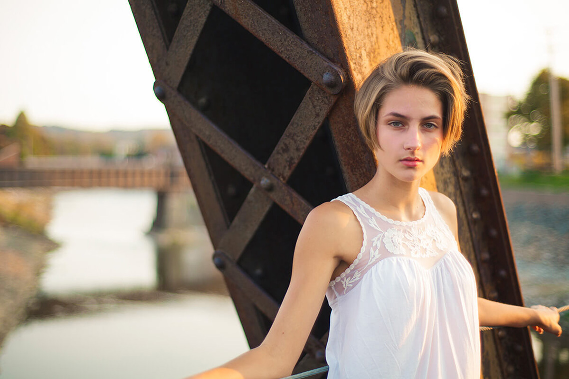 5-York-PA-Senior-Portraits-Ken-Bruggeman-Photography-Girl-Standing-Train-Bridge-Over-Water.jpg