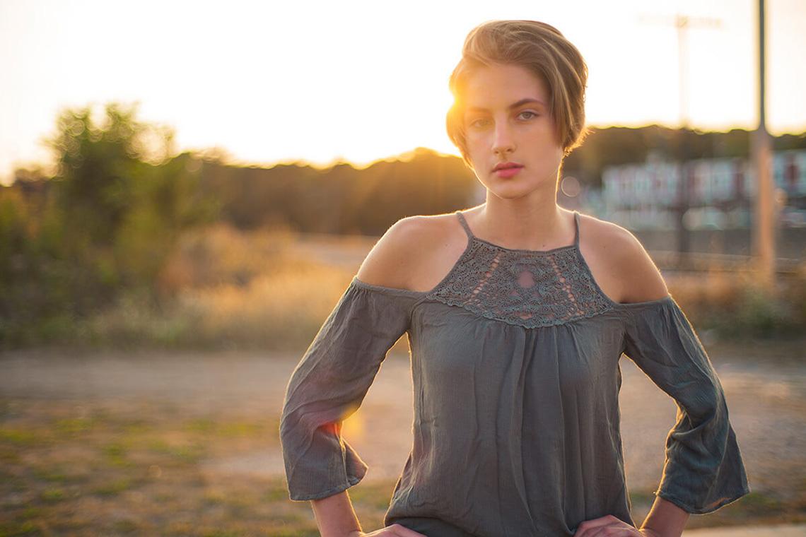 11-York-PA-Senior-Portraits-Ken-Bruggeman-Photography-Girl-Stanind-Green-Shirt-Sunlight.jpg