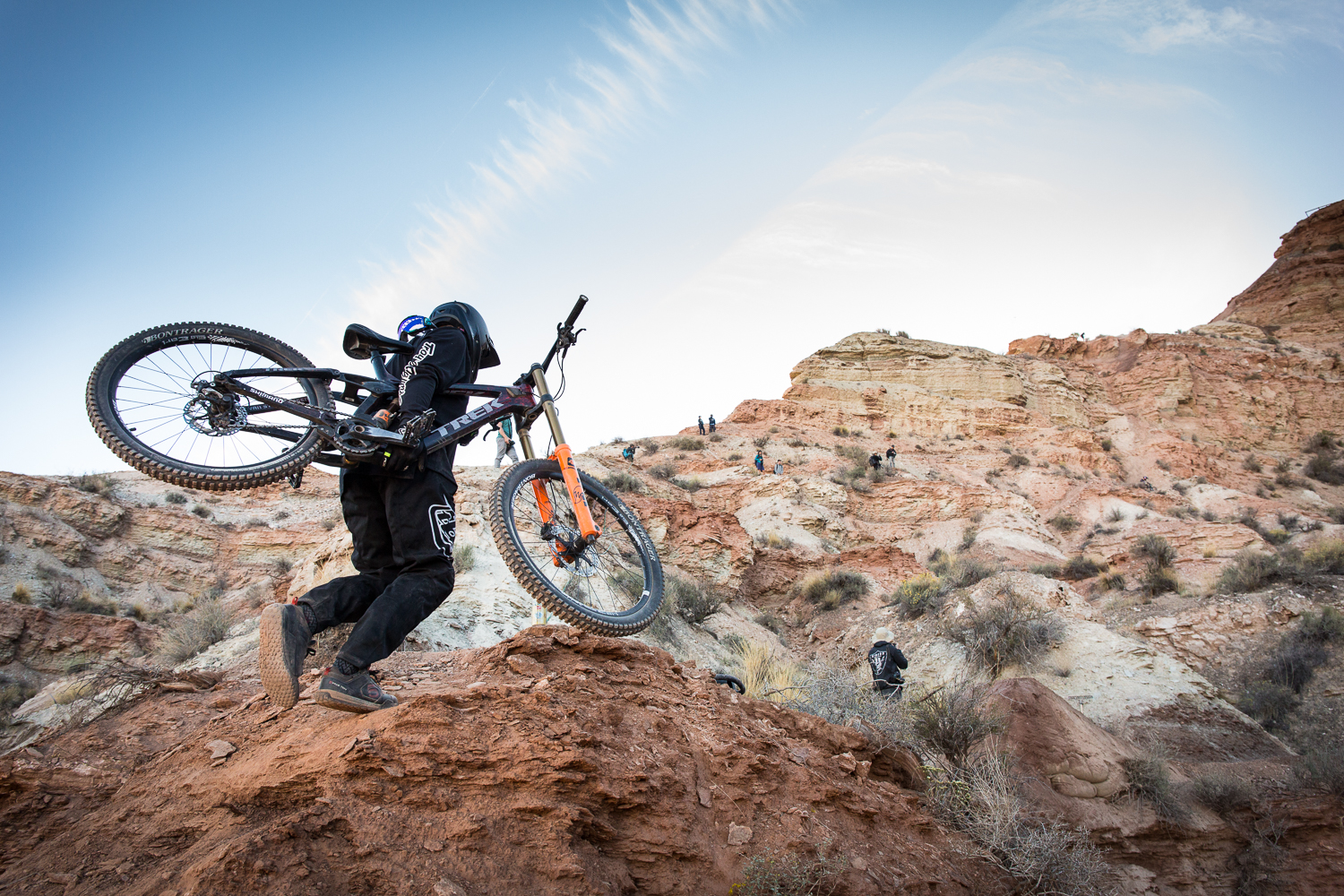 Tom Van Steenbergen hiking to the top of his line on the first practice day