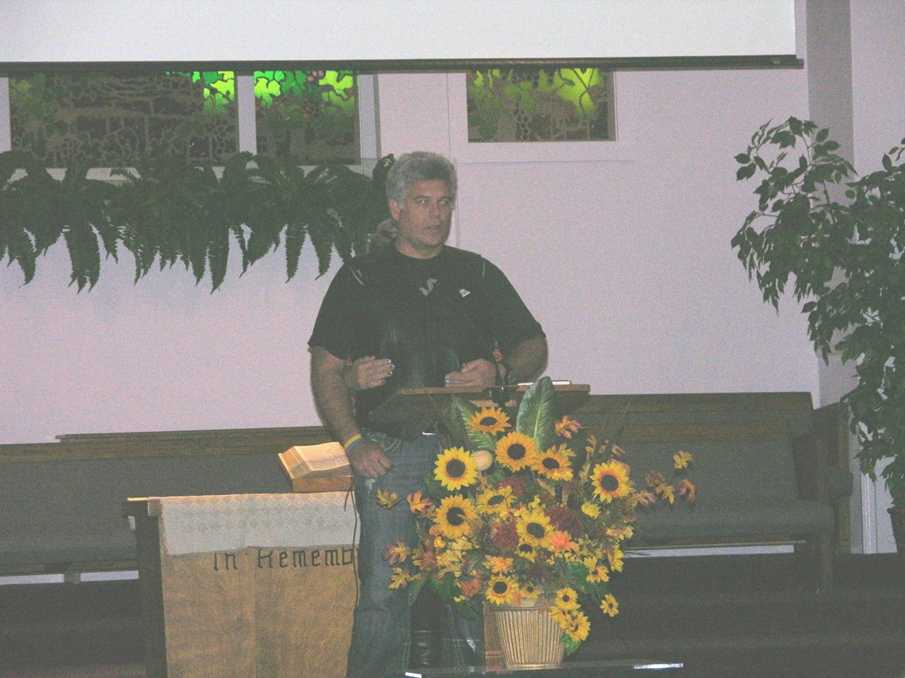 Biker Sabbath in St. Helena - Jonathan Sharing their story with Traci Hugging him from behind.jpg