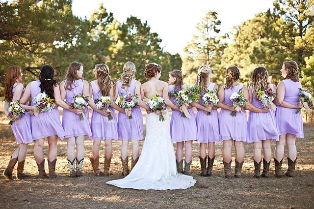 What a fun cowgirl wedding!! Beautiful pics by @sarajoyphotography #rusticwedding #coloradowedding #cowboyboots selahheatherdesign.com/megan-mike