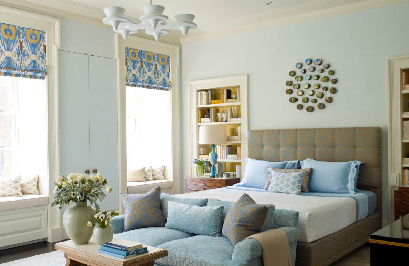 This bedroom by Steven Gambrel takes a layered approach to color.  Note the varied shades of blue, offset by sunshine yellow accents in the bookshelf and textiles.  Again, this is an easy example to imagine those accents in another color.  How would the room feel different with accents in navy, green, or coral?