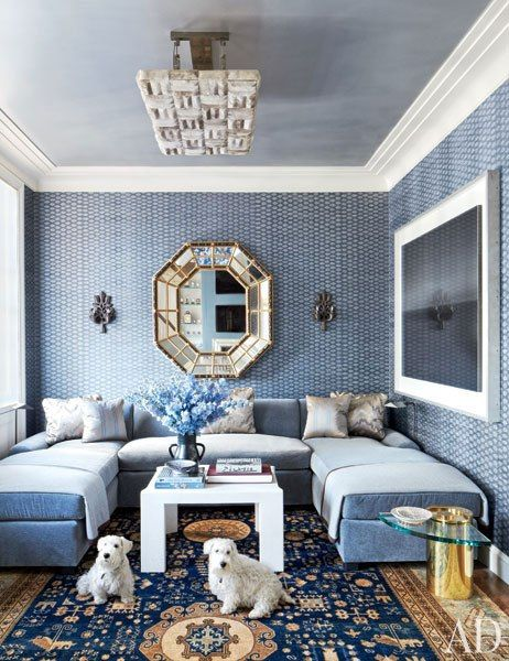 This elegant den features icy blue mixed with velvet, mirror, and crystal textures, for glamorous effect.  Notice the ground effect created by the dark navy rug and slightly lighter ceiling tone.  You're enveloped in color, but with a clearer sense of place than the Steele or Fairley spaces.  Den by Michael S. Smith, as featured in Architectural Digest.