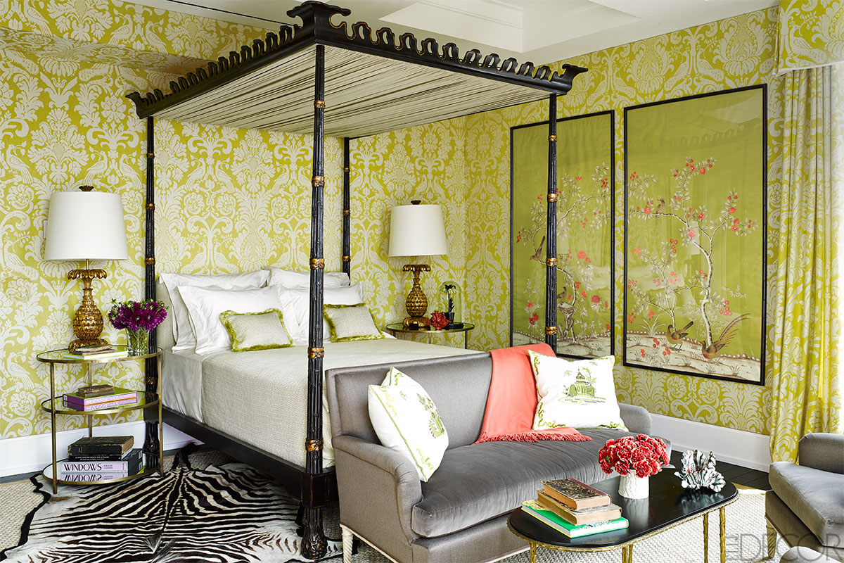Damask and chinoiserie go modern in this vibrant bedroom by Alessandra Branca.  The space could almost be monochromatic, but for accents in a watermelon tone.  How would the space be different?