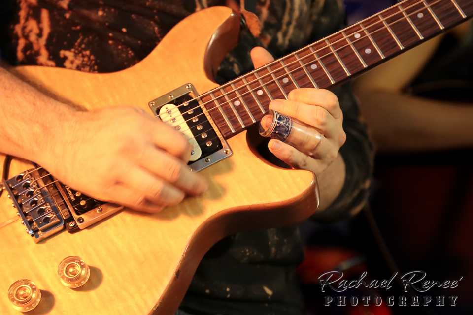 Note to self - 1/60th of a second is not fast enough to freeze a guitar player's picking hand.