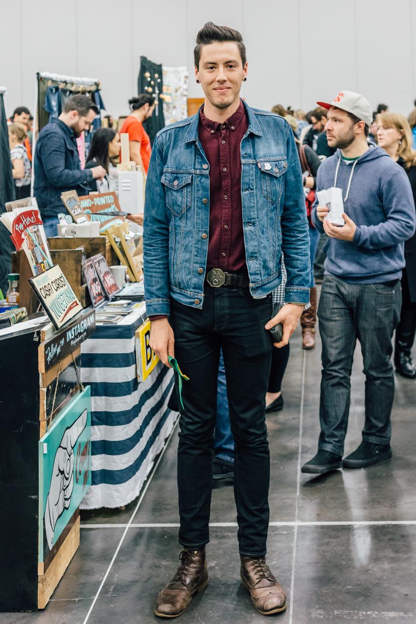 The Portland rocker look - denim, denim, big-ish belt buckle and boots. I bet he's a musician.