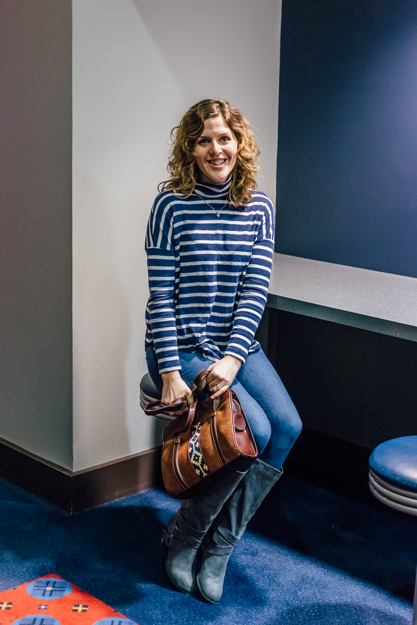 Striped shirt paired with denim and tall boots is always a win. The bag is a bonus.