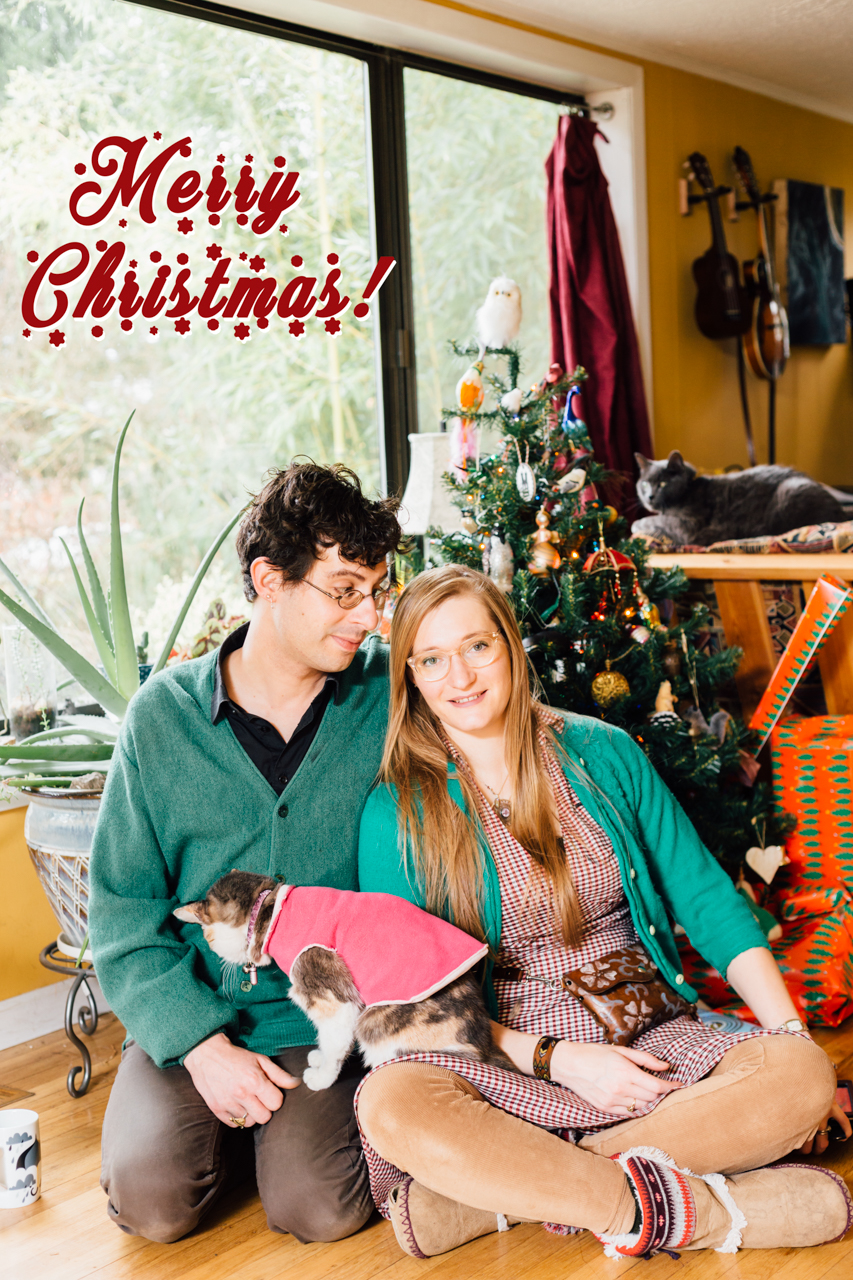 My husband Michael, Echo in the pink cape,Ruben on the futon top and I all just happen to celebrate Christmas. :)