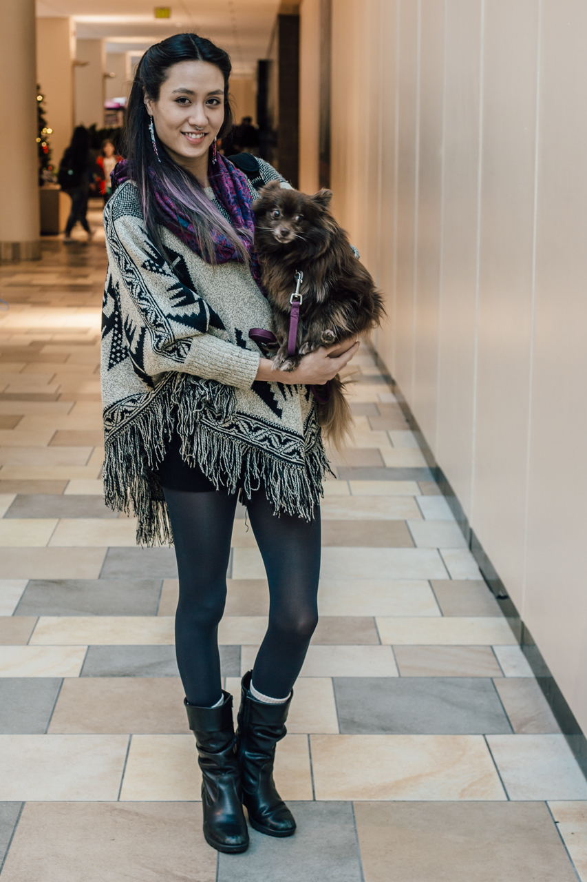A poncho and a pomeranian. This gal knows how to accessorize with style.