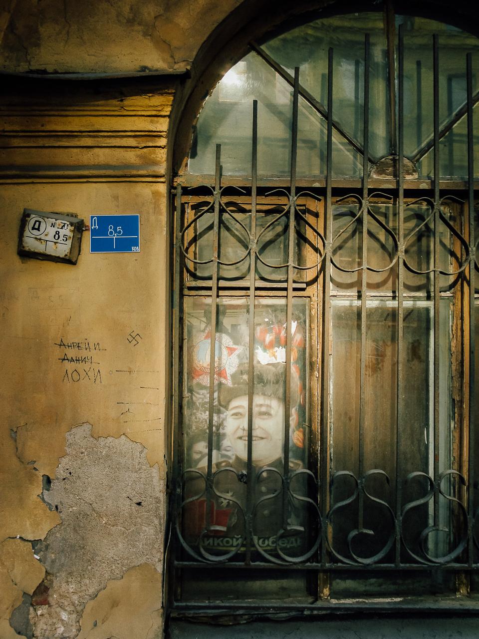 A Soviet era poster still resides in a window in St. Petersburg, Russia