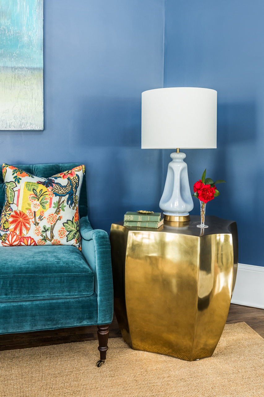 This image is a single shot of a detail of the room using natural light supplemented with my strobes in 2 places to preserve the existing shadows of the lamp on the wall and maintain dimensionality.