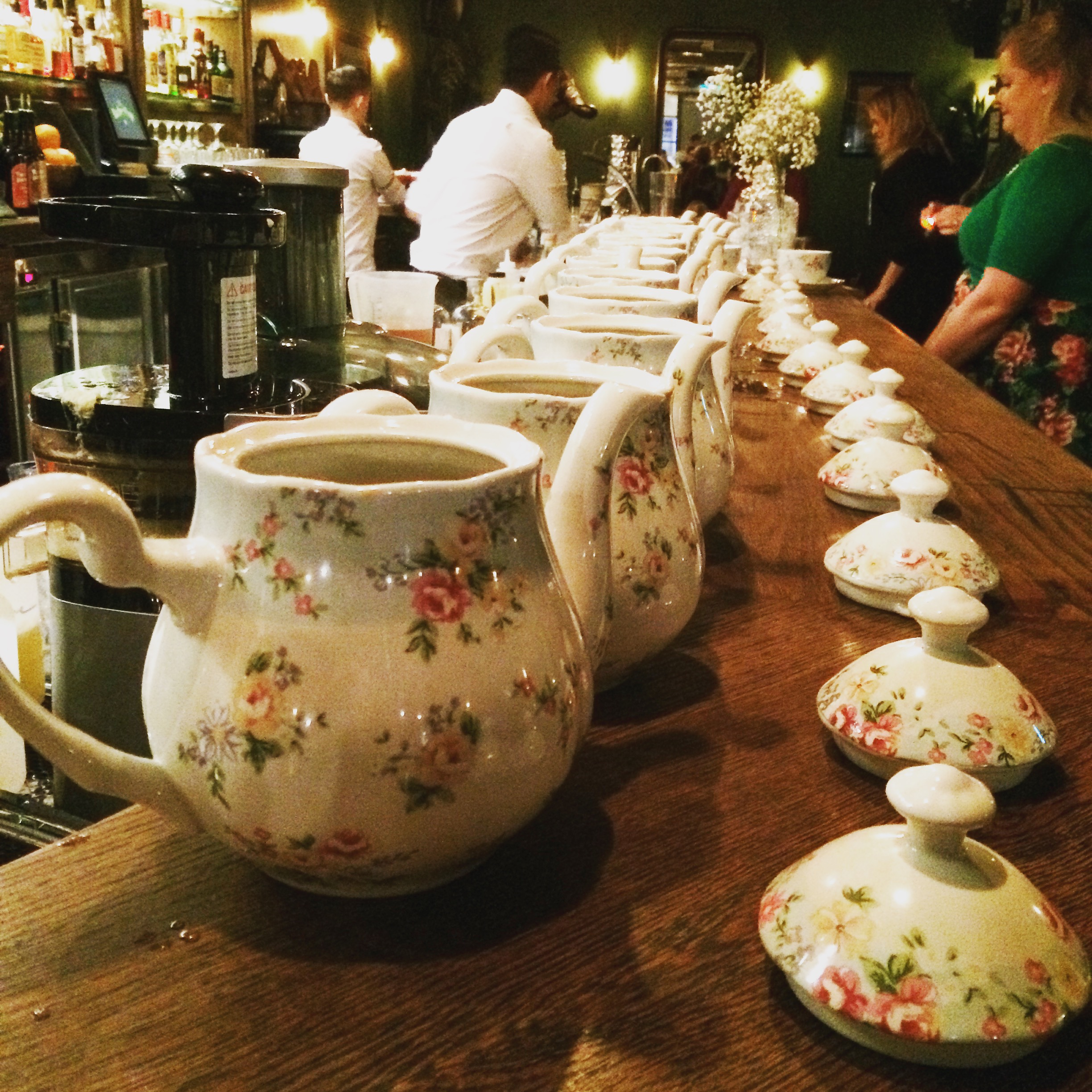 Tipsy teapots all in a row - teapot cocktail with Loch gin, peppermint, green tea and pineapple, which all combined to produce a cocktail tasting like boozed up chamomile tea
