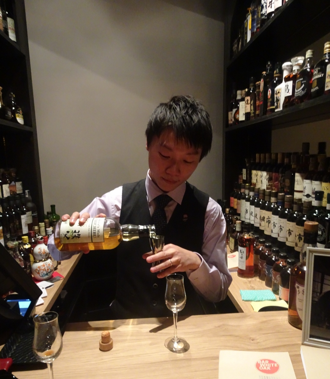 """Pop up curator Kelvin Low pouring a dram - you will find him in this spot most nights guiding punters through the whiskies """"on exhibit."""""""