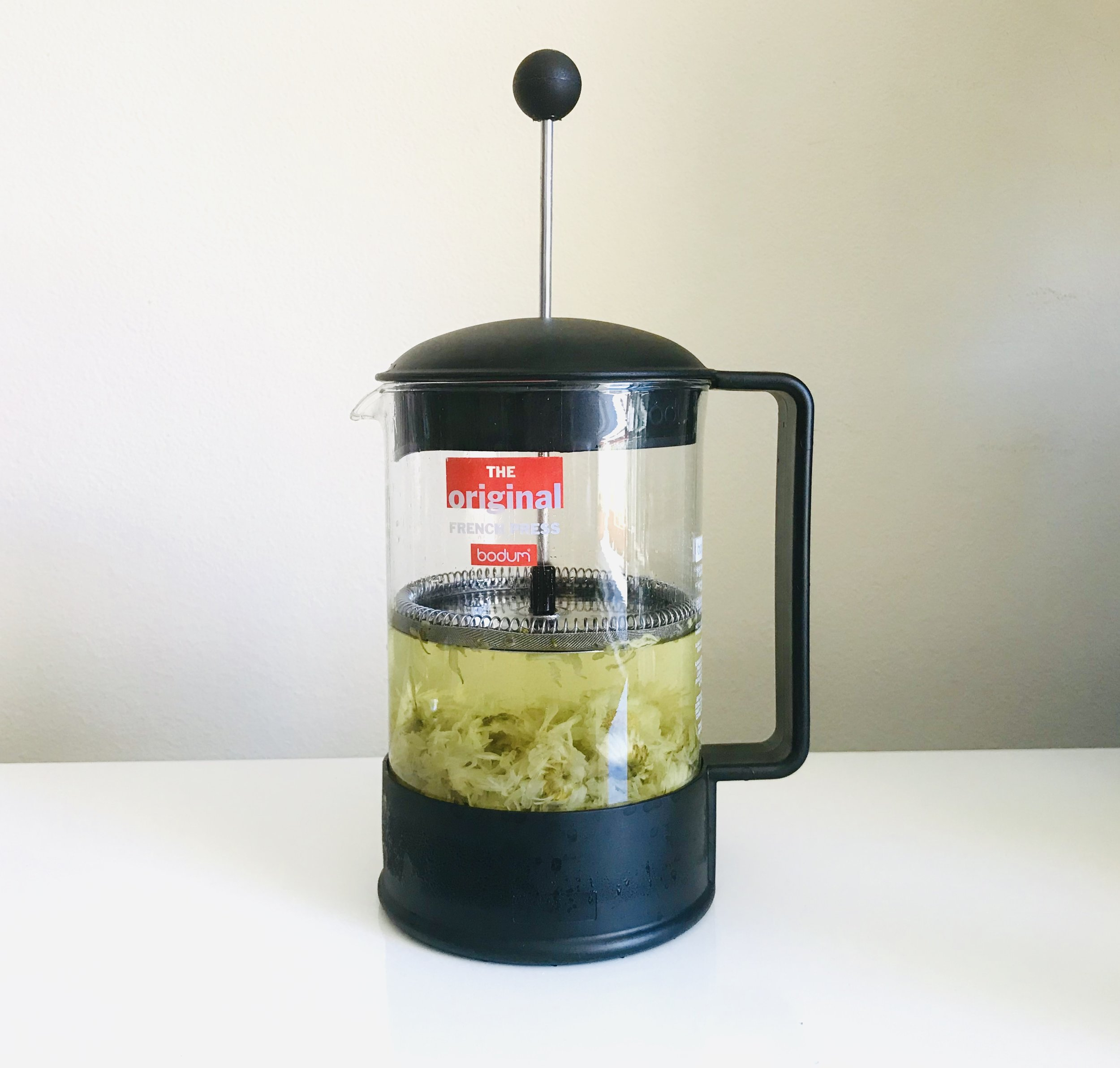 We used a normal coffee plunger (this is the 8 cup coffee maker from Bodum) to make the chrysanthemum tea. After infusing, you simply press the plunger down and pour the tea as normal.