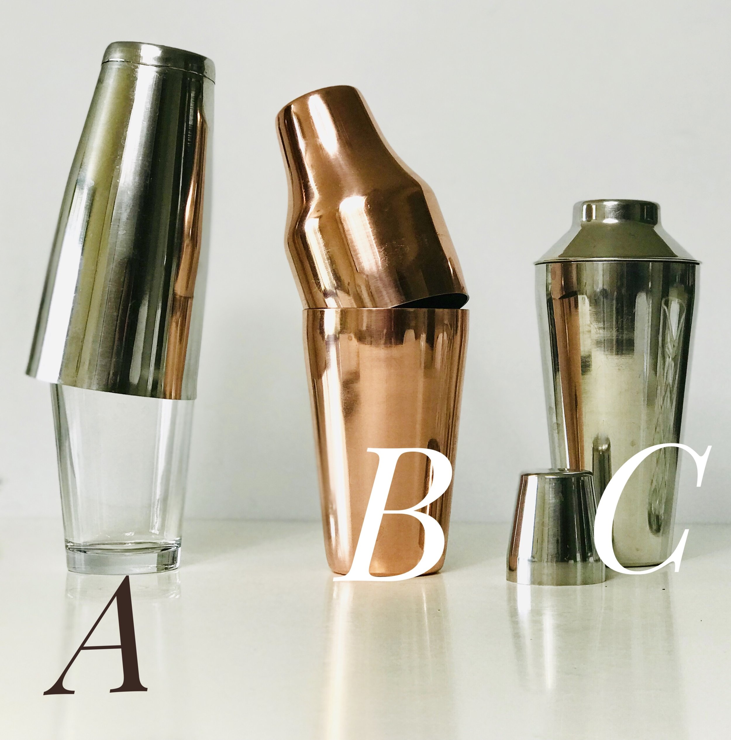 Line up of different cocktail shakers