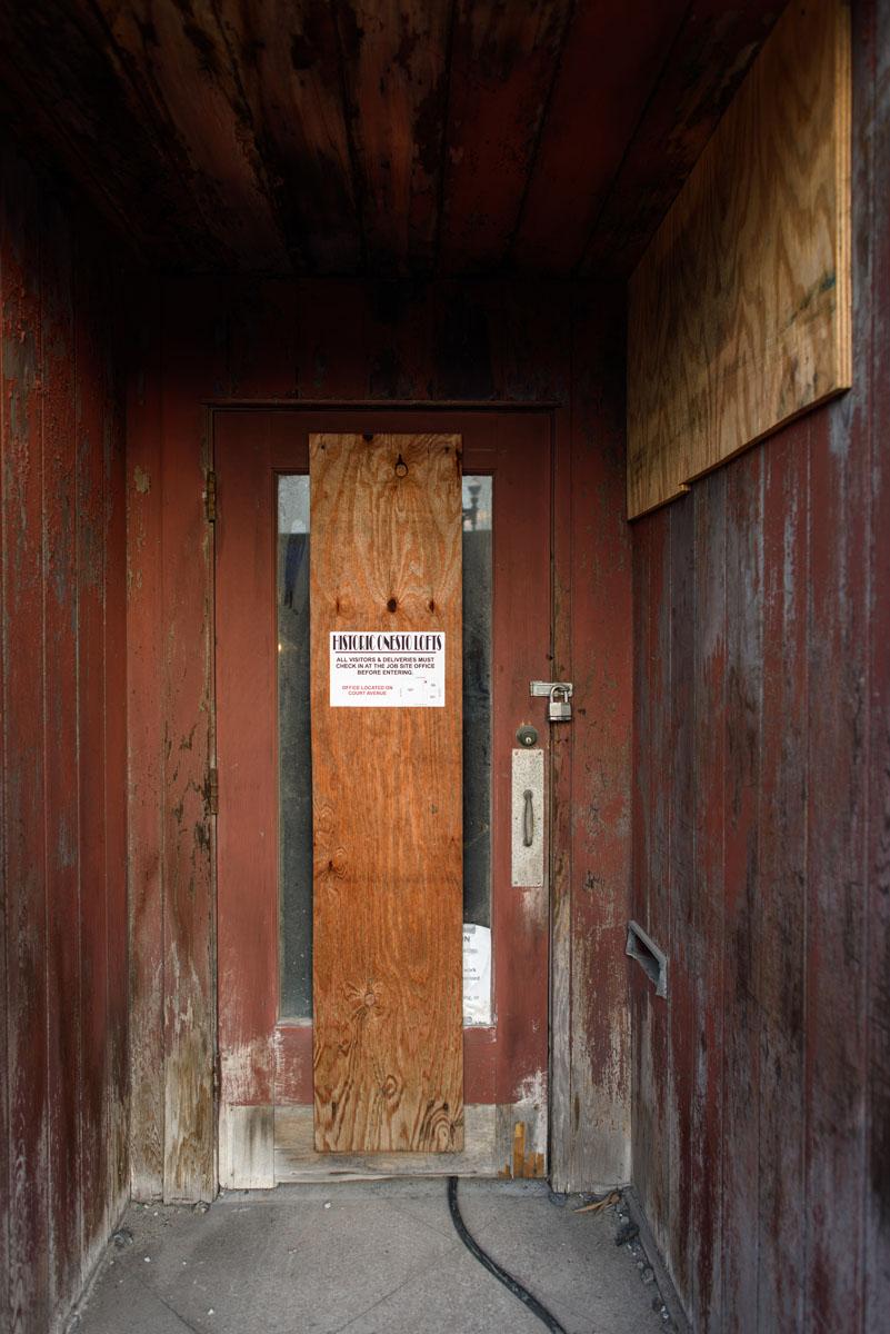 Construction door with Onesto Lofts info