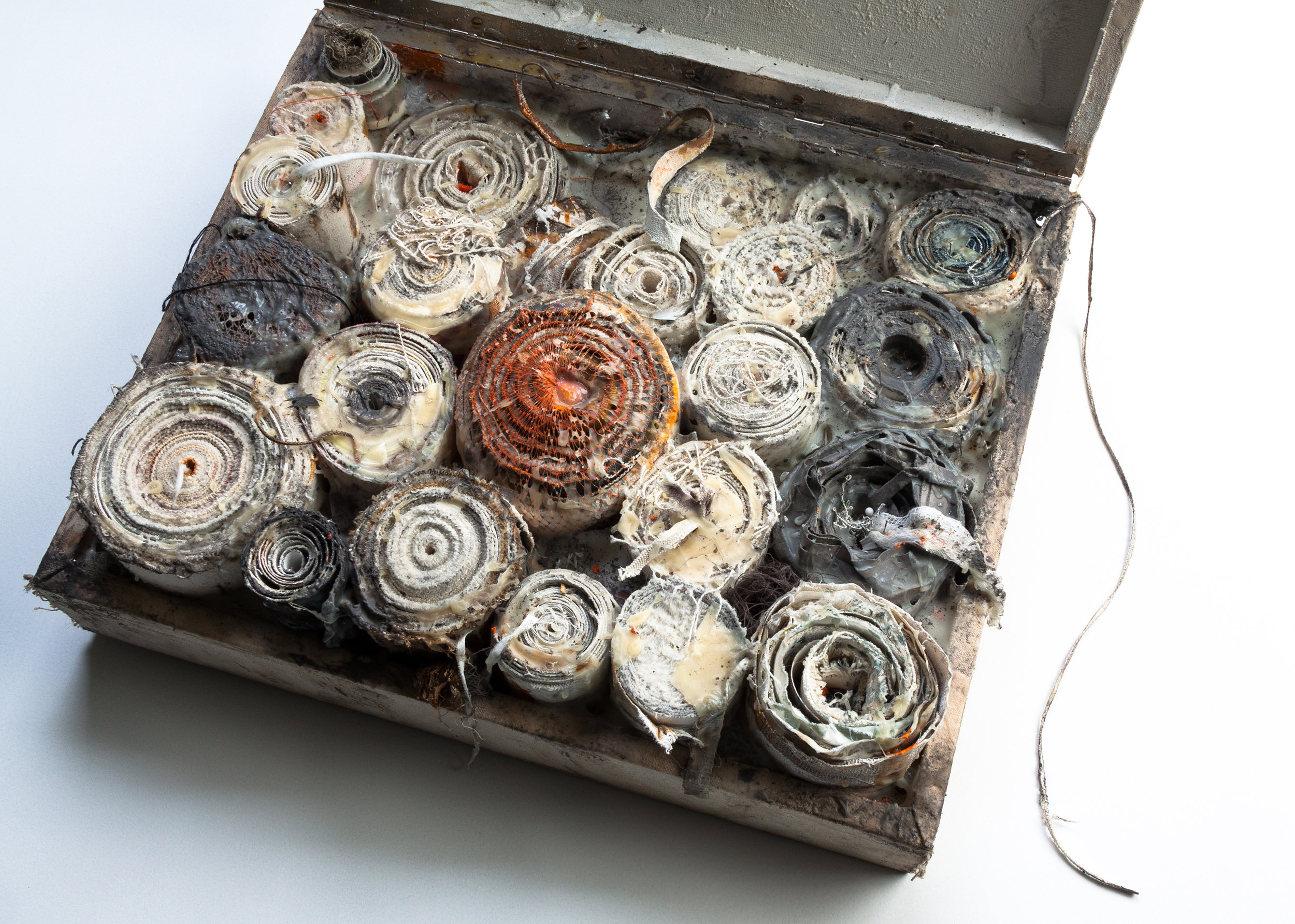 Scrolls in a box. Oil, acrylic pigment, found muck, wood glue, felt, cotton thread, pins, canvas, wooden box covered in canvas, metal stand. 170 x 43,5 x 35,5 cm