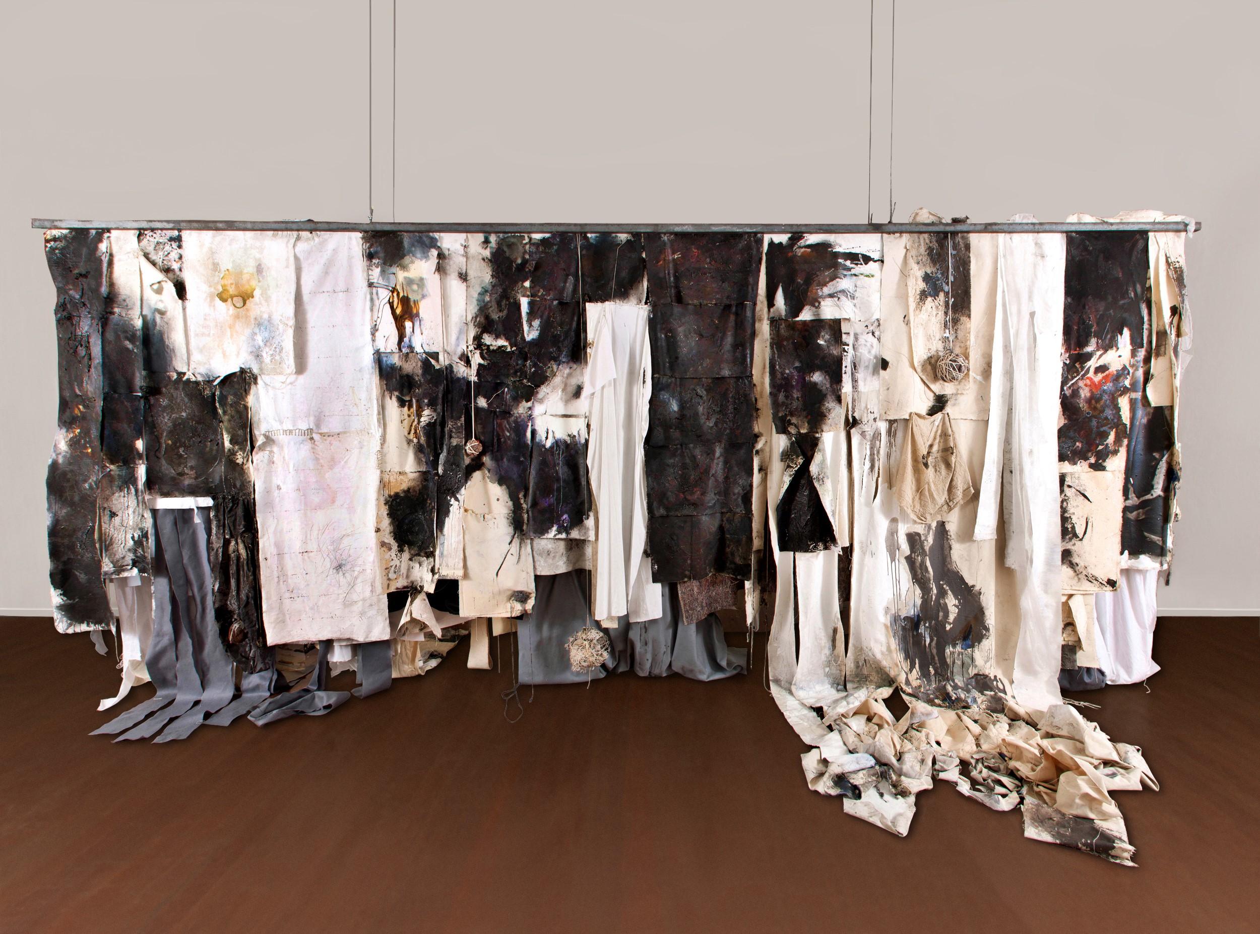 Melancholia. Oil, acrylic, wood ash, industrial enamel, found muck, wood glue, resin, bedding, felt, canvas. 250 x 600 x 36 cm.