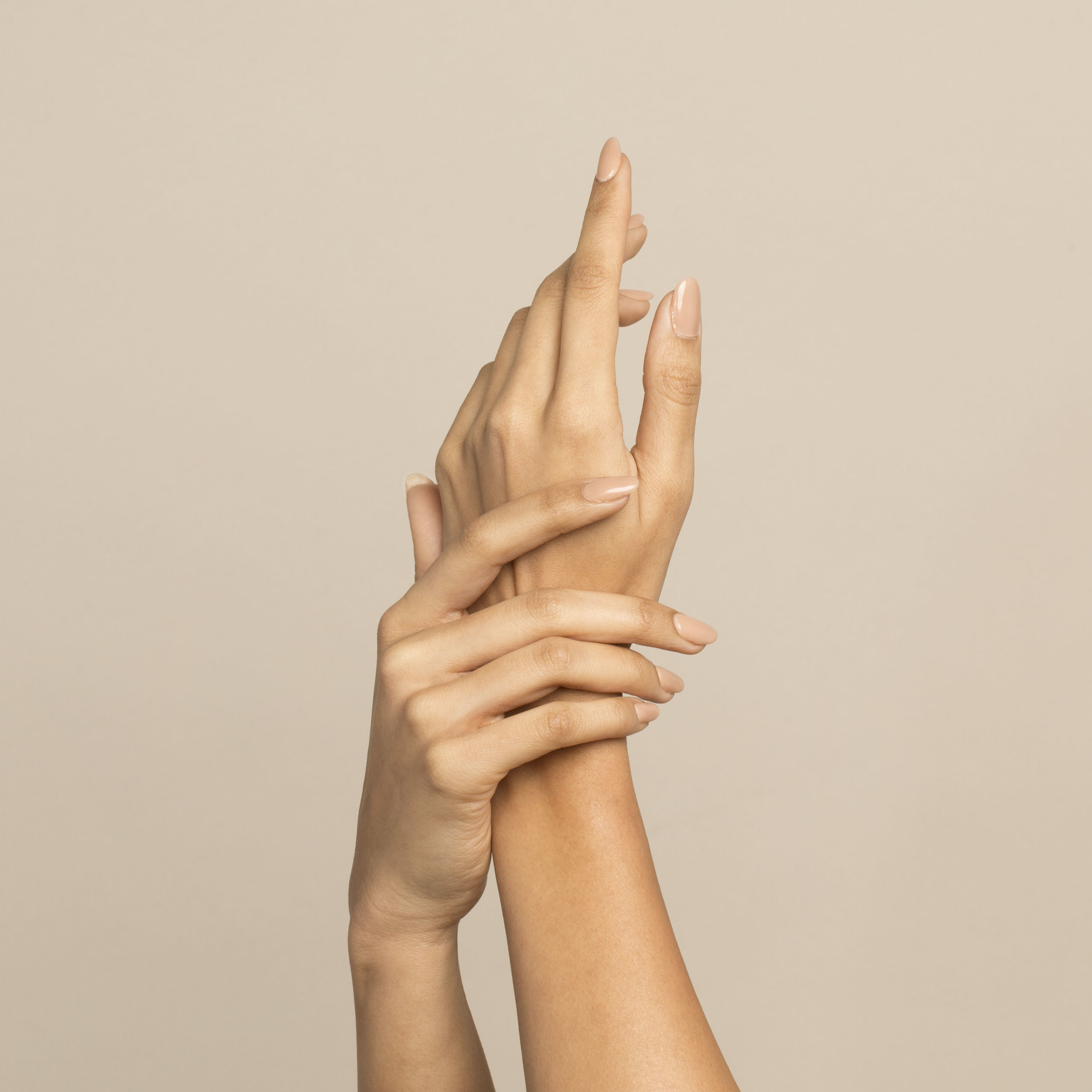 youthful brown skin female hands with manicure