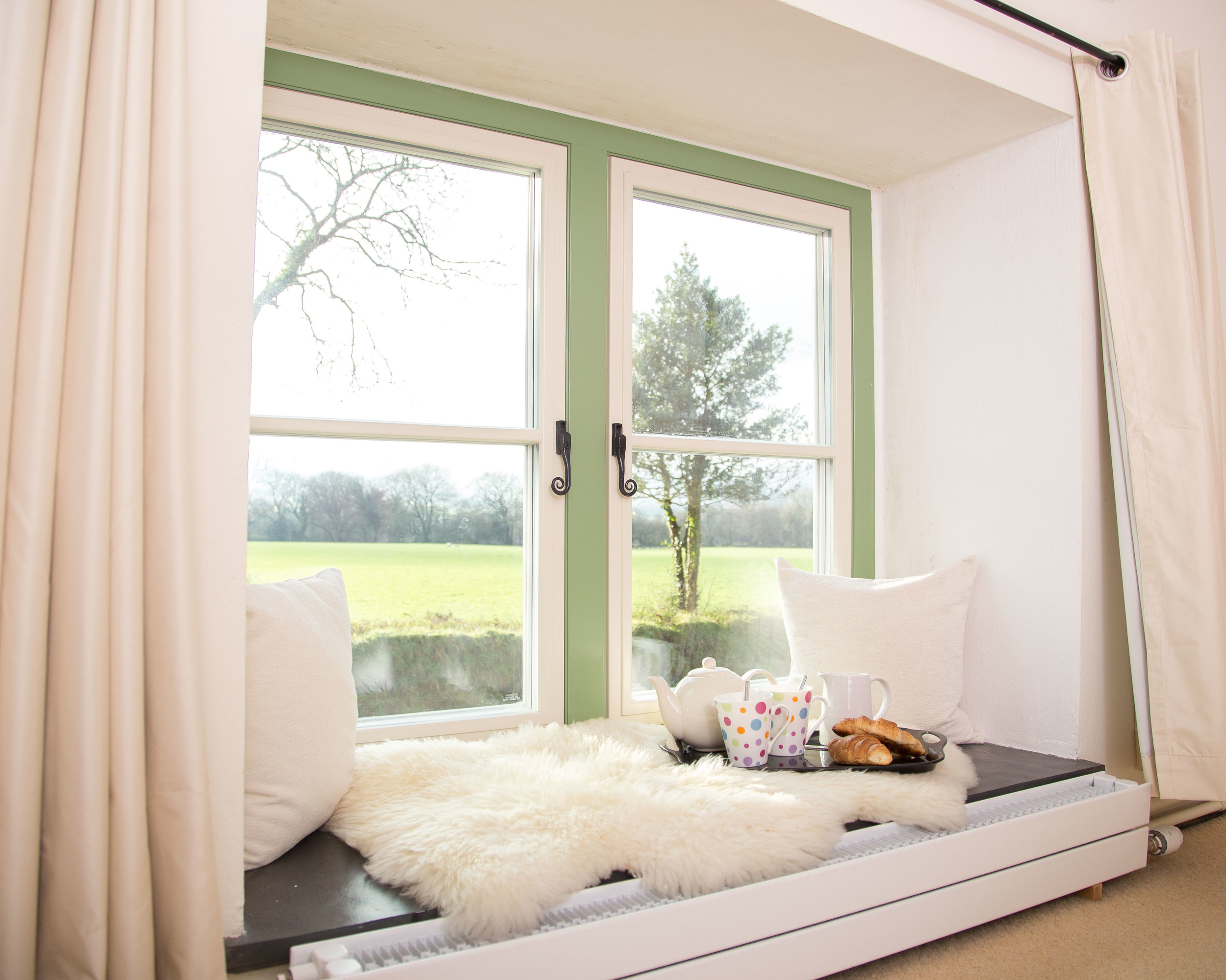 Cosy bedroom window seats