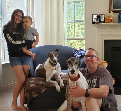 "Congratulations to Patrick and Becky (not present) for Adopting Willy from Philly, now just Willy, also known as ""mini-me"" as the other look-alike Greyhound, Sebastian!  Willy is an adorable Greyhound who just loves being in the active family with the daughter Jordan and grandson, Andy. Willy enjoys sunning himself in the yard and snuggling with the family on the couch. He's adjusting to many new things and is doing amazingly well!  We are thrilled to have Patrick, Becky, Jordan, Andy with Willy and Sebastian back in the BRGA pack!"