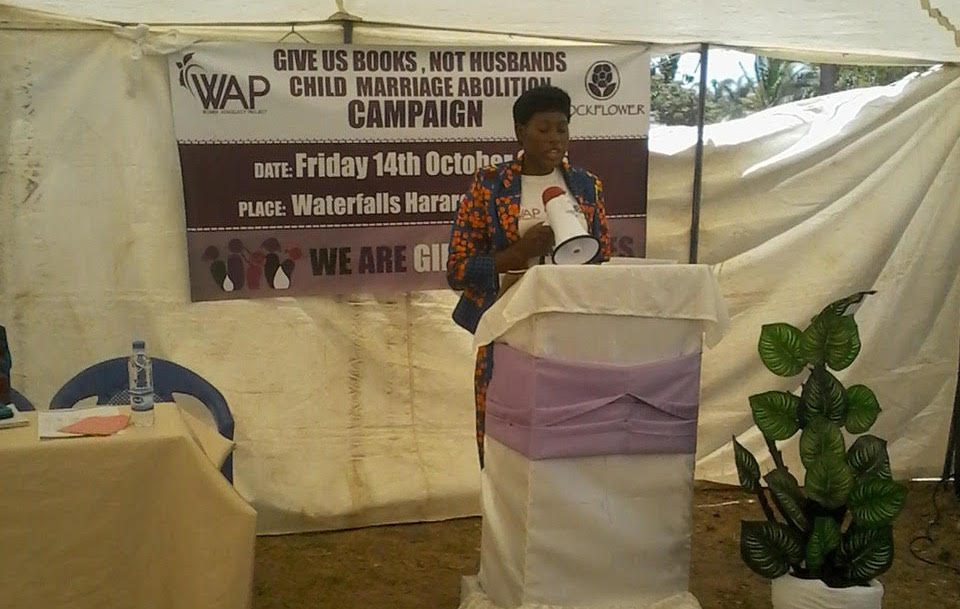 Constance Mugari, Executive Director, speaking at Give Us Books, Not Husbands event.
