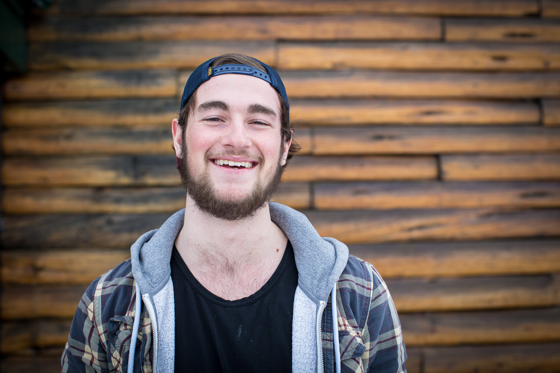 Ashley Barker Photography British Columbia Calum Petit Lodge Plaid Trucker Hat Wood Beard Happy Powder