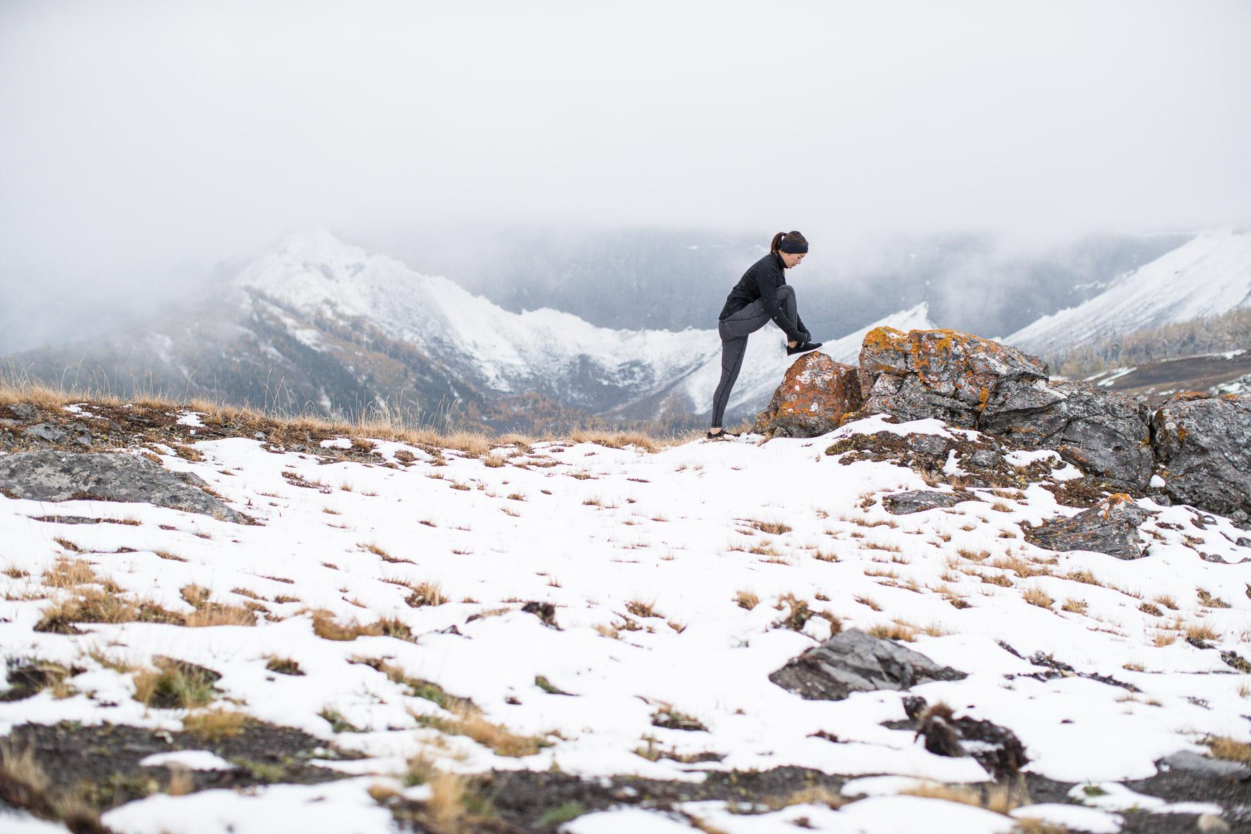 Ashley Barker LuluLemon Banff Mountain Tops Snow Fog Composition Rocks Stretching