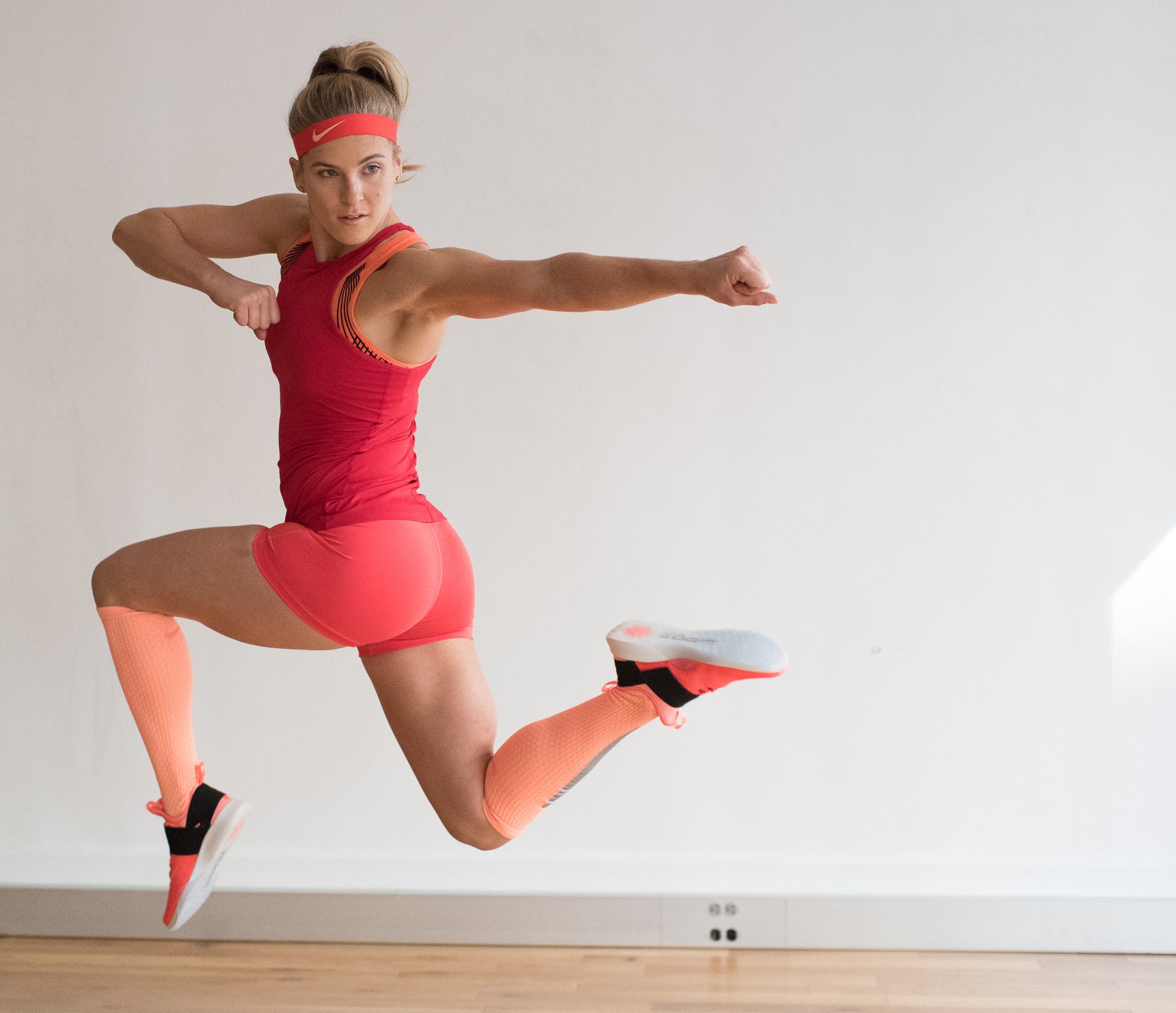 Ashley Barker Photographer Natural Nike NYC Jump Punch Strength Red Studio