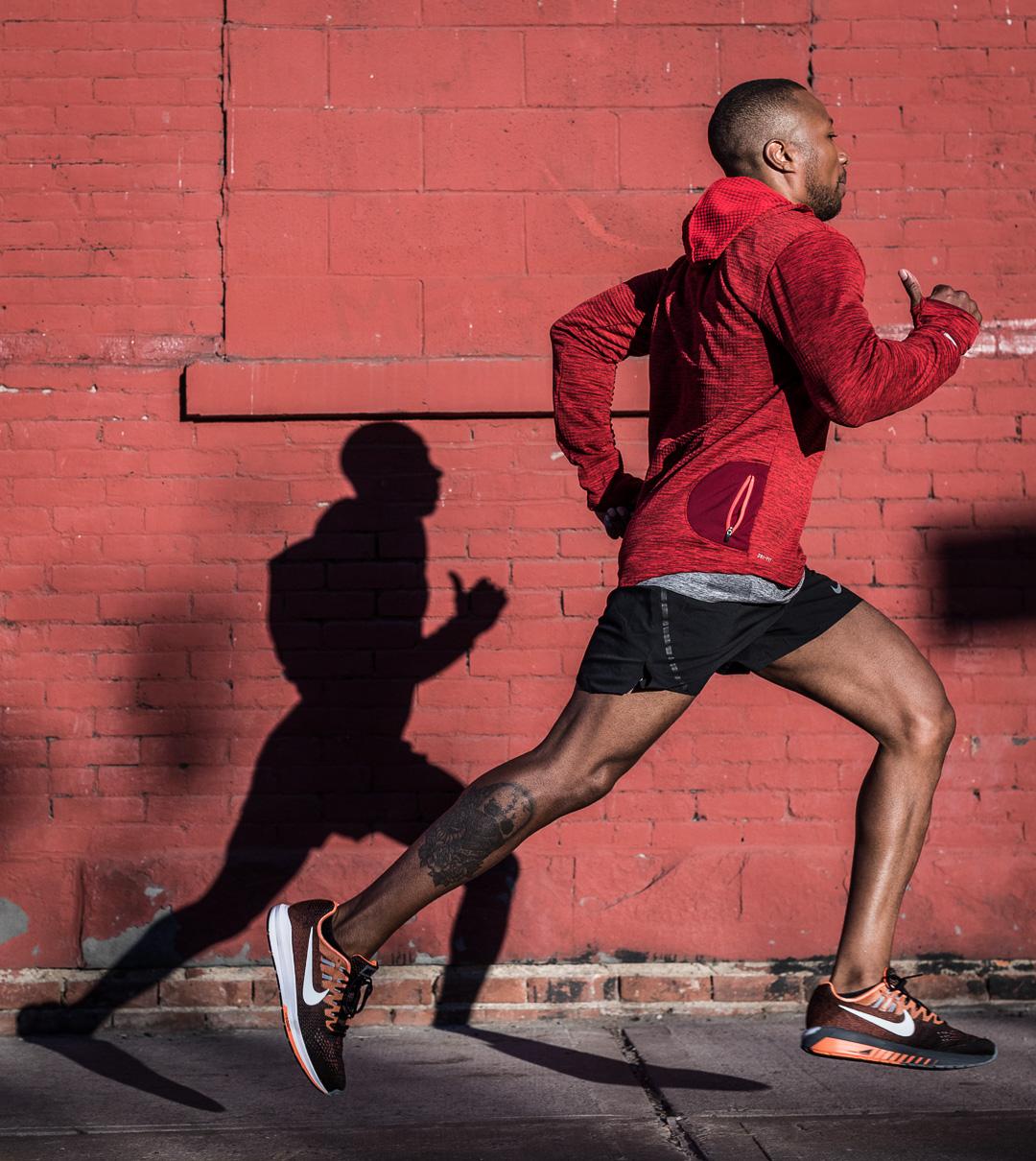 Ashley Barker Photography Nike New York Running Shadows Brick Wall Red Jacket Shorts Concrete