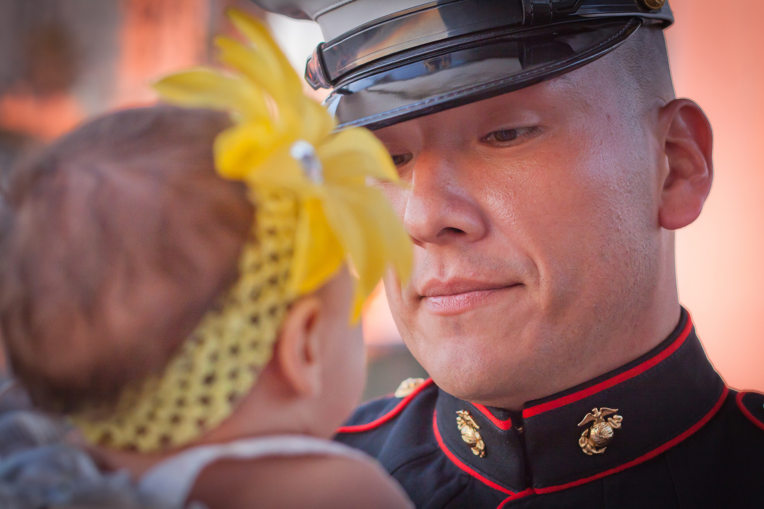 """I asked him how long he was going to be in Afghanistan. He said 6 months. He wasn't sure if he would return this time...His new born daughter being more than six months old I asked him:""""So you'll miss her first birthday?"""" and I caught his look into her eyes...."""