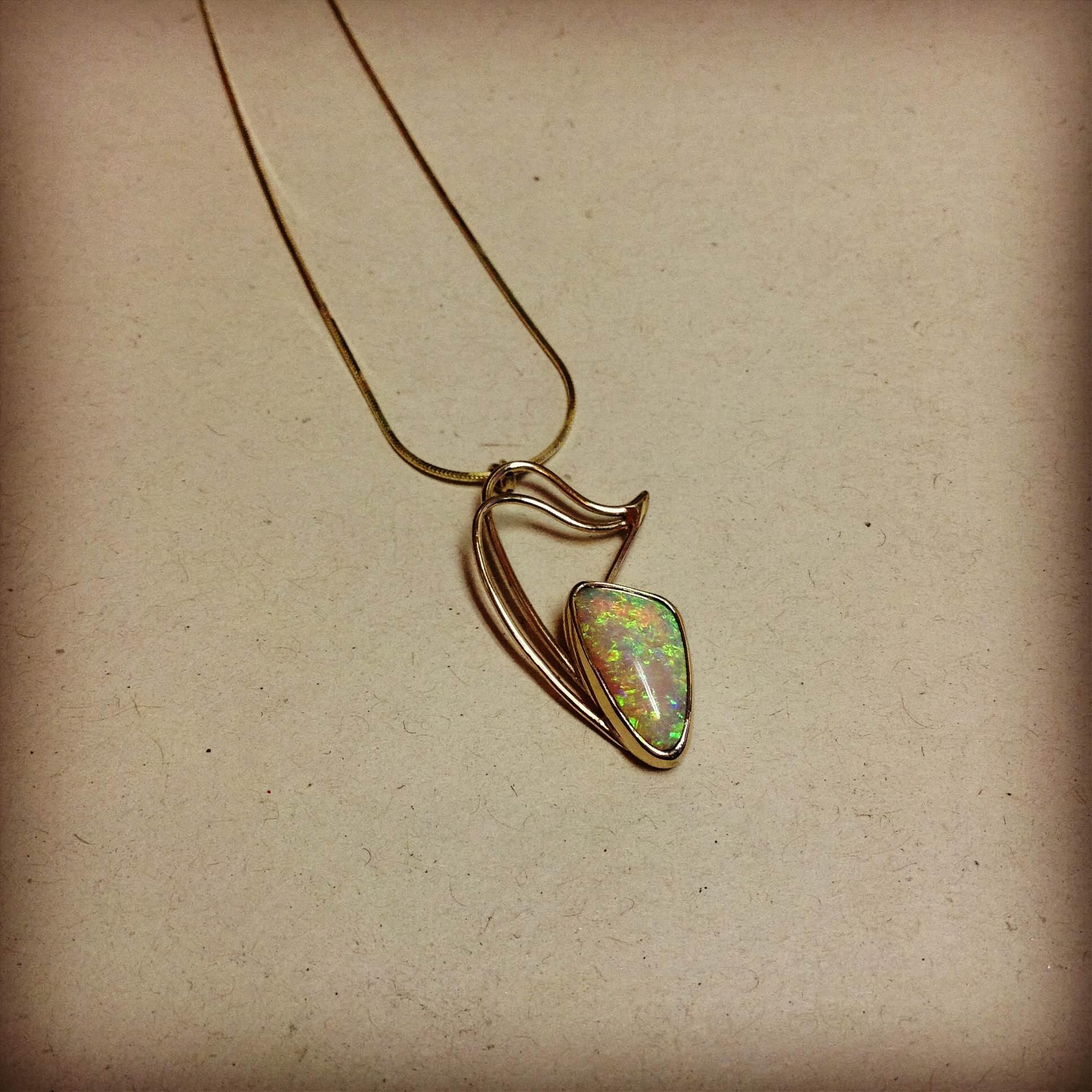 Opal gold pendant