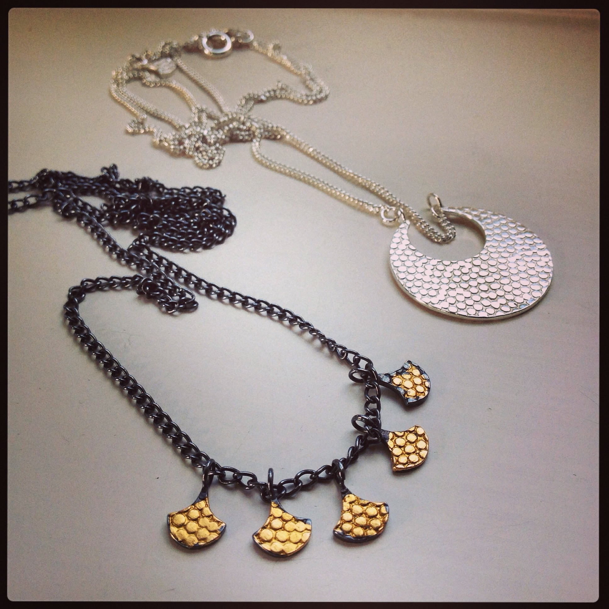 Sophia Hargreaves Jewellery, bespoke black/gold Athena necklace(pictured left) and Athena Silver Pendant (pictured right).