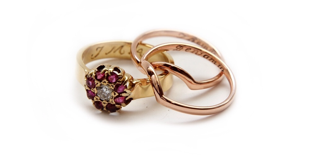 New and improved Ruby ring accompanied by two rose gold contoured bands.