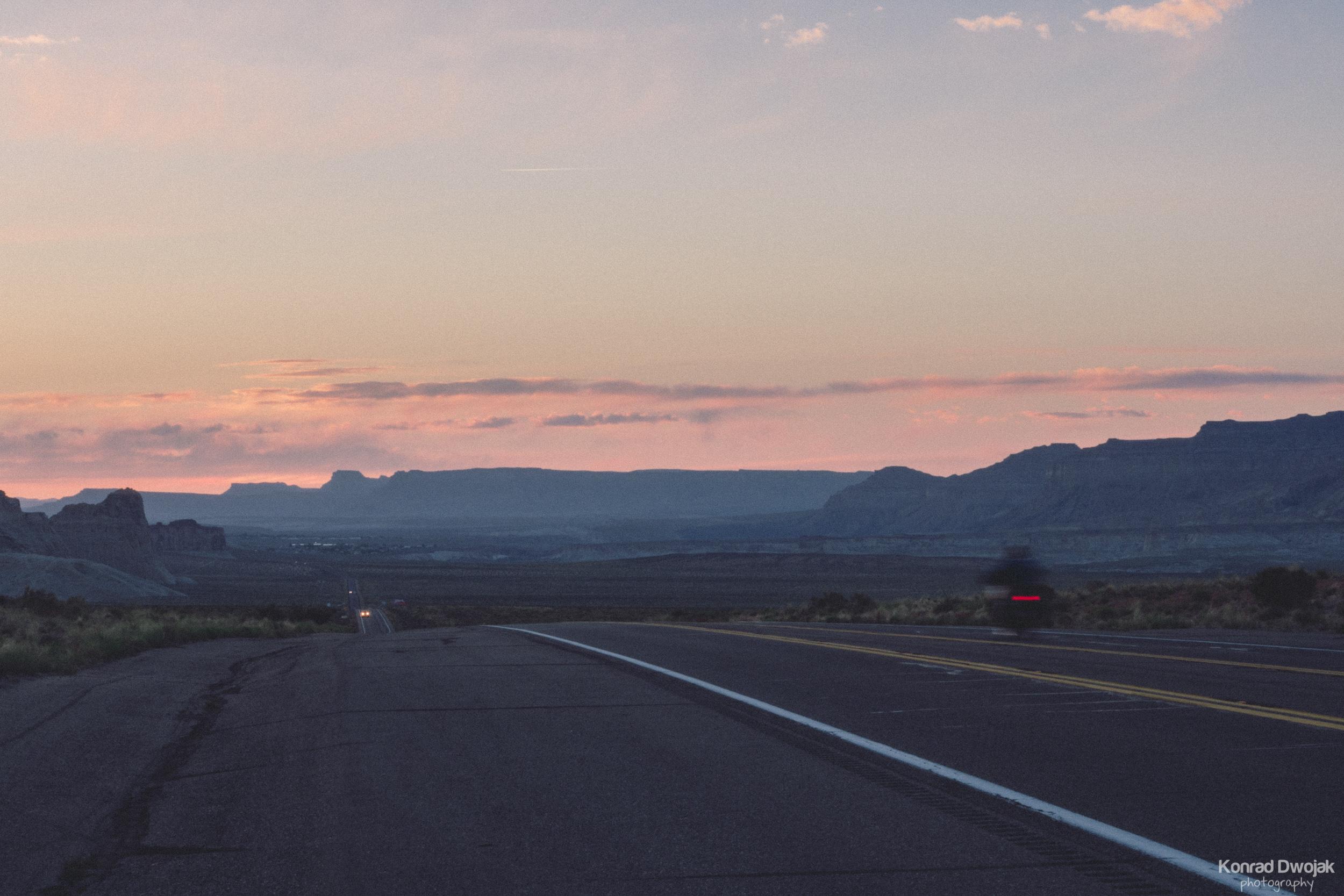 Sunset and Road Trip Travellers near Big Water, Utah