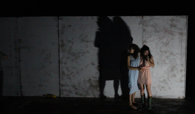 Antigone and Ismene - lit by one lantern