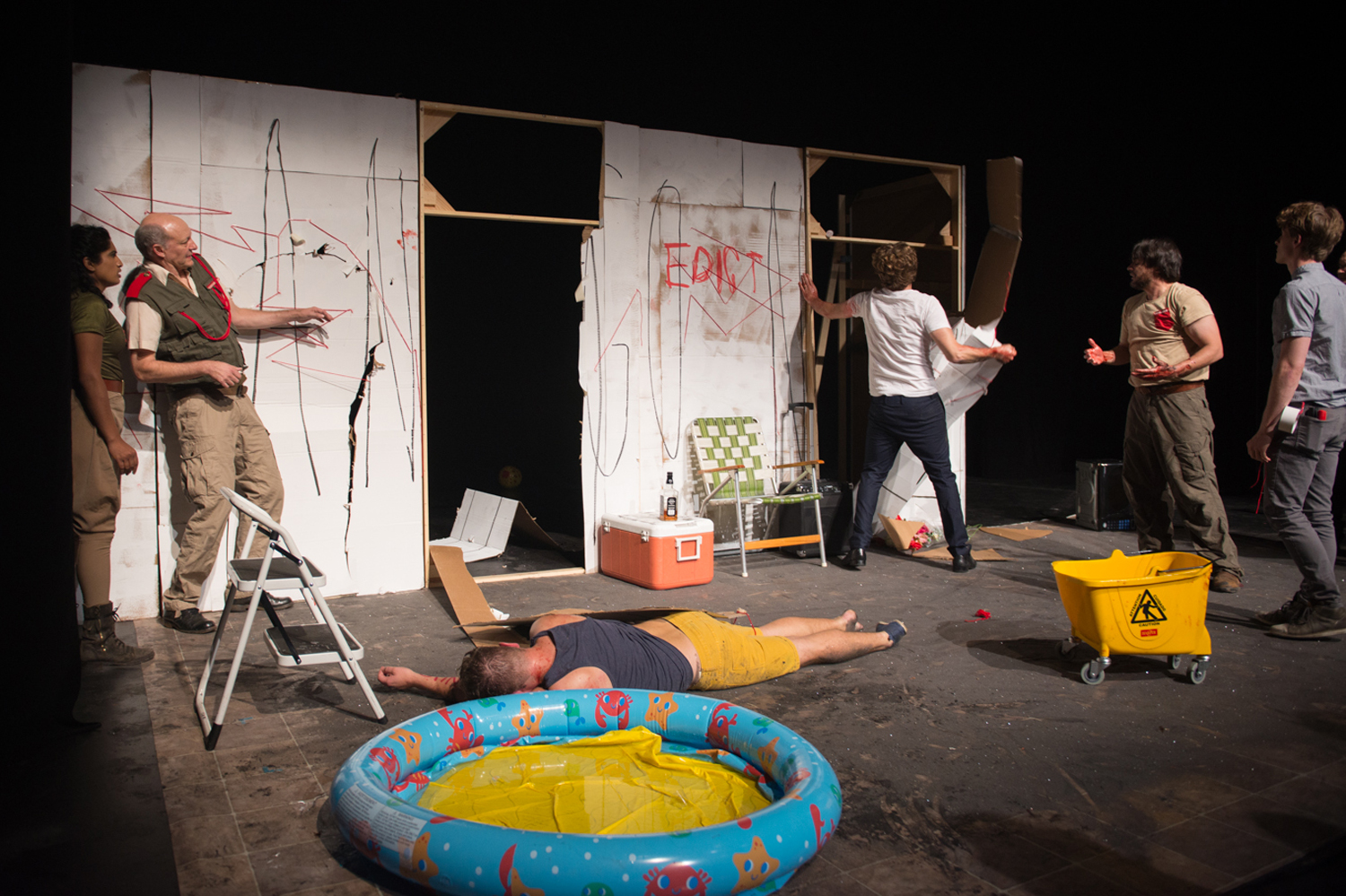 After he drags on his dead son, Kreon rips the cardboard off the walls. Photo by Dahlia Katz.