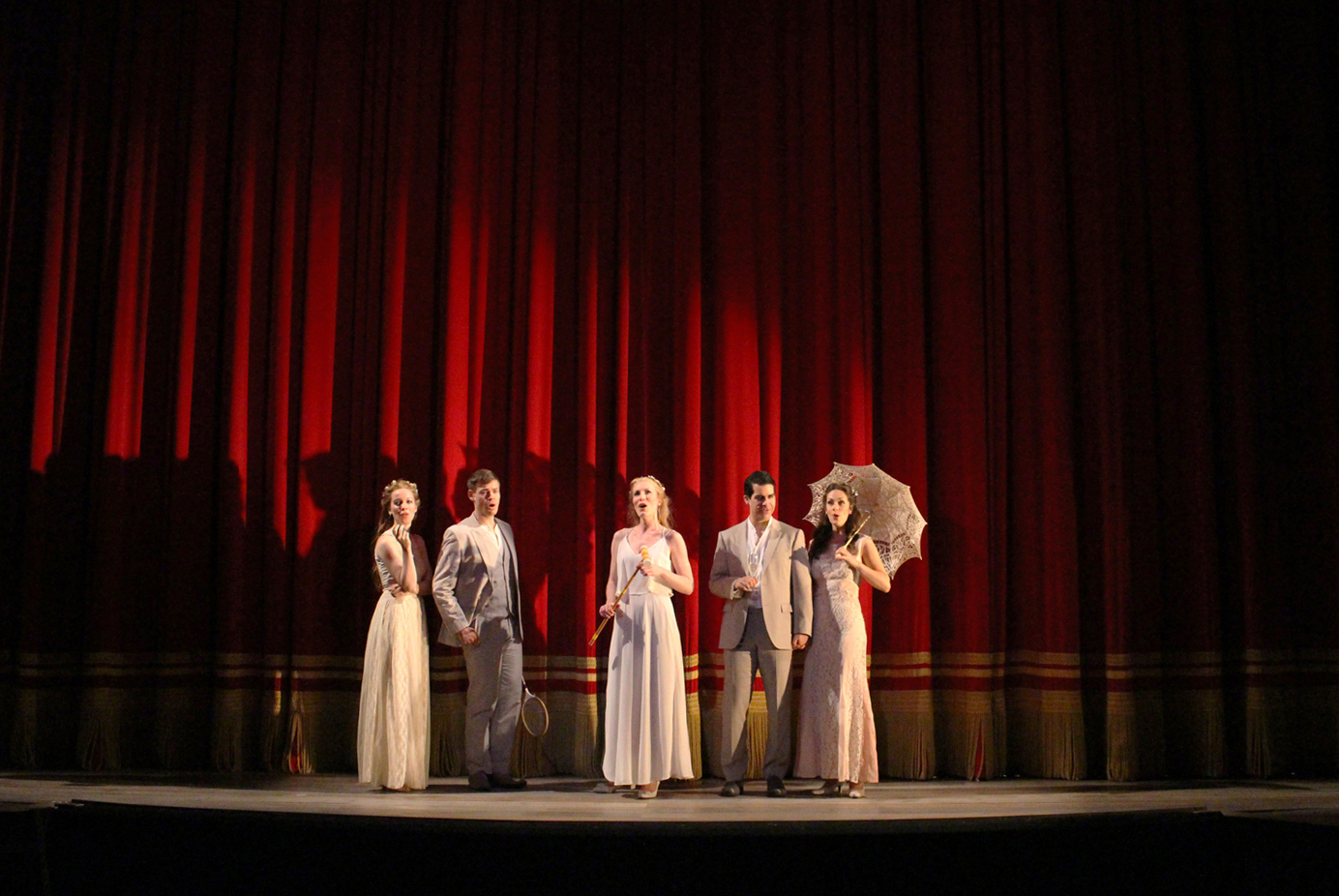 Act II also begins with Liebeslieder singers in front of red curtain