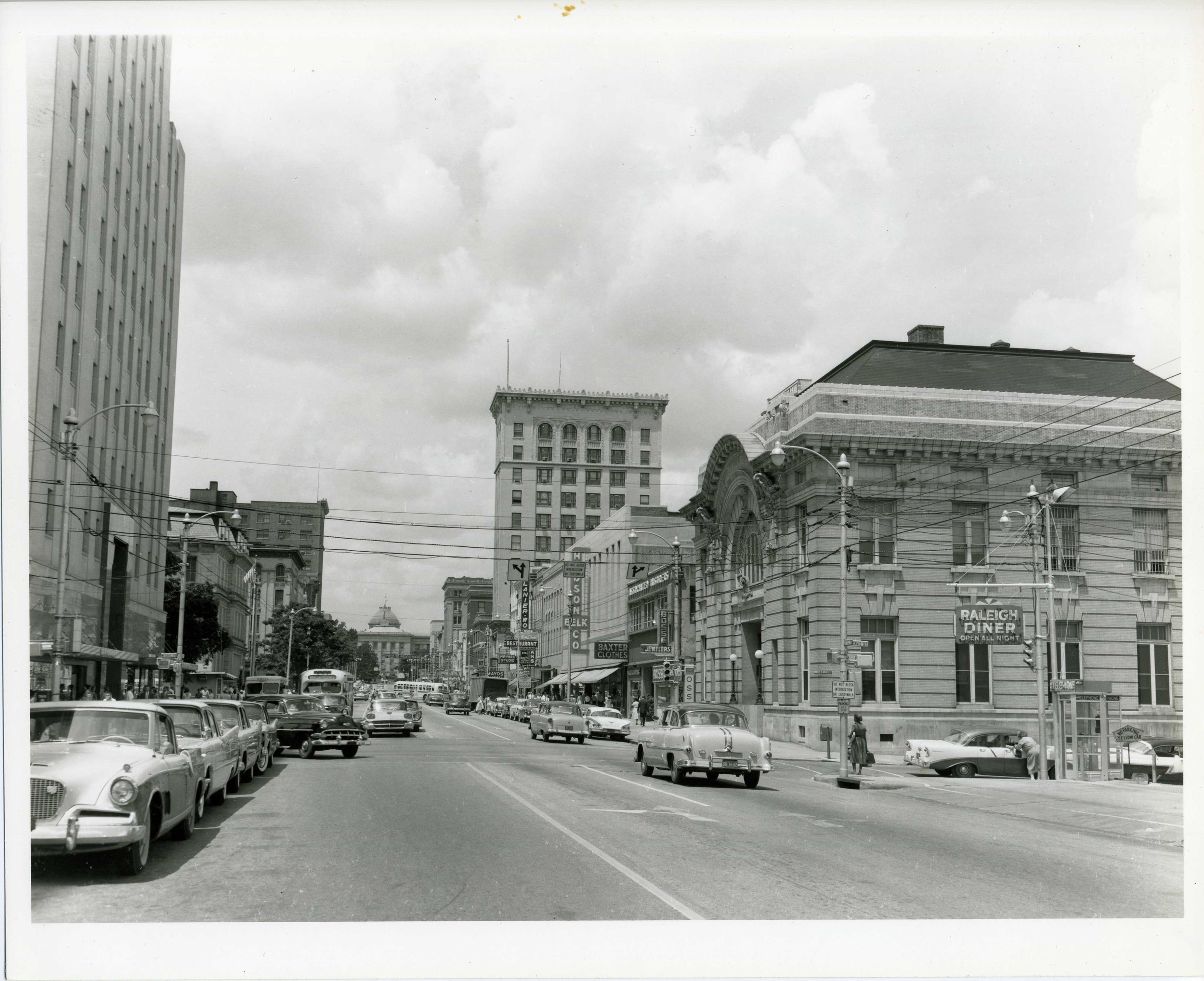 300 block of Fayetteville Street looking north to the State Capitol - Raleigh City Hall on the right. Photo ca. 1955 - Photo by Madlin Futrell.  General Collection, State Archives of North Carolina