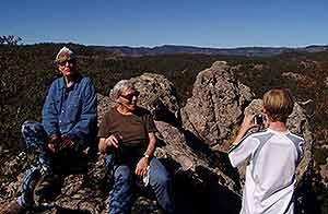 Three generation family enjoying views from rock formations