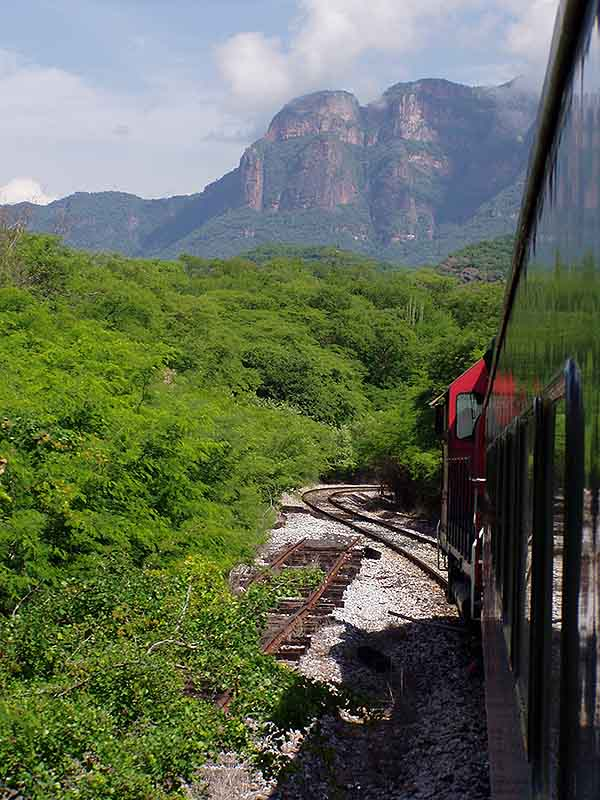 The world-famous Chihuahua al Pacifico train enters the Septentrion Gorge